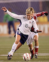 """USA's Aly Wagner takes the ball away from Anne Dot Eggers of Denmark. The US Women's National Team tied the Denmark Women's National Team 1 to 1 during game 8 of the 10 game the """"Fan Celebration Tour"""" at Giant's Stadium, East Rutherford, NJ, on Wednesday, November 3, 2004.."""