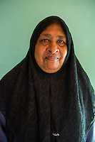 Maldives, Fenfushi Island, Muslim woman, runs home for the boat builders. (MR)
