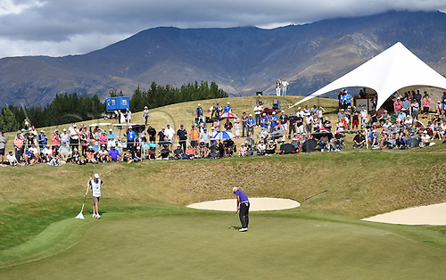 13.03.2016. Arrowtown, New Zealand.  General view of the 10th green as Michael Hendry putts during round 4 at The Hills during 2016 BMW ISPS Handa New Zealand Open. Sunday 13 March 2016.