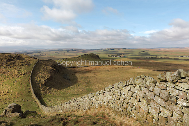 Section of Hadrian's Wall East of Cawfields Wall and South of Cawburn, Northumberland, England. Hadrian's Wall was built 73 miles across Britannia, now England, 122-128 AD, under the reign of Emperor Hadrian, ruled 117-138, to mark the Northern extent of the Roman Empire and guard against barbarian attacks from the Picts to the North. The wall was fortified with milecastles with 2 turrets in between, and a fort about every 5 Roman miles. This section of the Wall is in the Northumberland National Park, managed by English Heritage, and the Hadrian's Wall Path, an 84-mile coast to coast long distance footpath, runs alongside it, along with the Pennine Way. Picture by Manuel Cohen