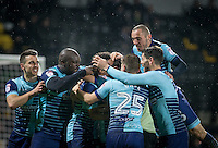 Teammates mob goalscorer Scott Kashket of Wycombe Wanderers during the Sky Bet League 2 match between Notts County and Wycombe Wanderers at Meadow Lane, Nottingham, England on 10 December 2016. Photo by Andy Rowland.