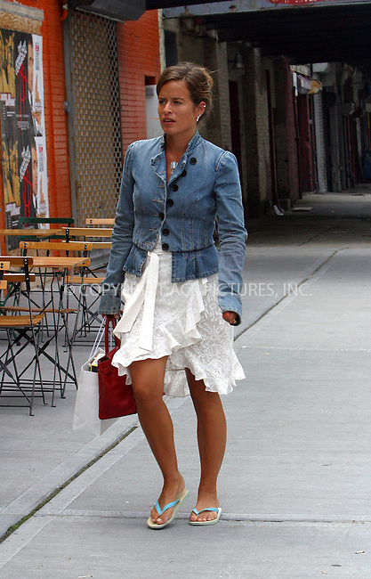 *** EXCLUSIVE ***..Lovely daughter of 'Rolling Stone' Mick, Jade Jagger, spotted taking a stroll in New York's Meatpacking District. Dressed casually, Jade looked fantastic under the sun in white ruffled dress, carrying red handbag which played well with her faded blue denim jacket and blue-and-white flip-flops. New York, July 11, 2003. Please byline: NY Photo Press.   ..*PAY-PER-USE*      ....NY Photo Press:  ..phone (646) 267-6913;   ..e-mail: info@nyphotopress.com