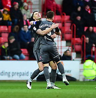 Lincoln City's Jason Shackell, left, celebrates scoring the opening goal with team-mate Lee Frecklington<br /> <br /> Photographer Andrew Vaughan/CameraSport<br /> <br /> The EFL Sky Bet League Two - Swindon Town v Lincoln City - Saturday 12th January 2019 - County Ground - Swindon<br /> <br /> World Copyright &copy; 2019 CameraSport. All rights reserved. 43 Linden Ave. Countesthorpe. Leicester. England. LE8 5PG - Tel: +44 (0) 116 277 4147 - admin@camerasport.com - www.camerasport.com