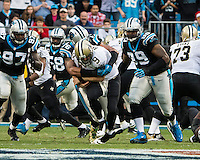The Carolina Panthers played the New Orleans Saints for supremacy in the NFC South.  December 22, 2013 at Bank of America Stadium.  The Panthers scored the winning touchdown with 23 seconds left in the game to give them the opportunity to clinch the NFC South with a win next week.  New Orleans Saints quarterback Drew Brees (9) is sacked by Carolina Panthers defensive end Greg Hardy (76)