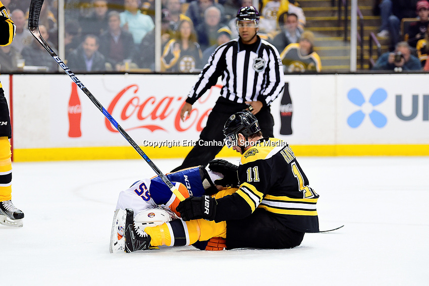 Tuesday, December 20, 2016: New York Islanders defenseman Johnny Boychuk (55) gets tangled with Boston Bruins right wing Jimmy Hayes (11) during the National Hockey League game between the New York Islanders and the Boston Bruins held at TD Garden, in Boston, Mass. Eric Canha/CSM