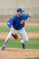 Scott Maine #57 of the Chicago Cubs participates in pitchers fielding practice during spring training workouts at the Cubs complex on February 19, 2011  in Mesa, Arizona. .Photo by Bill Mitchell / Four Seam Images.