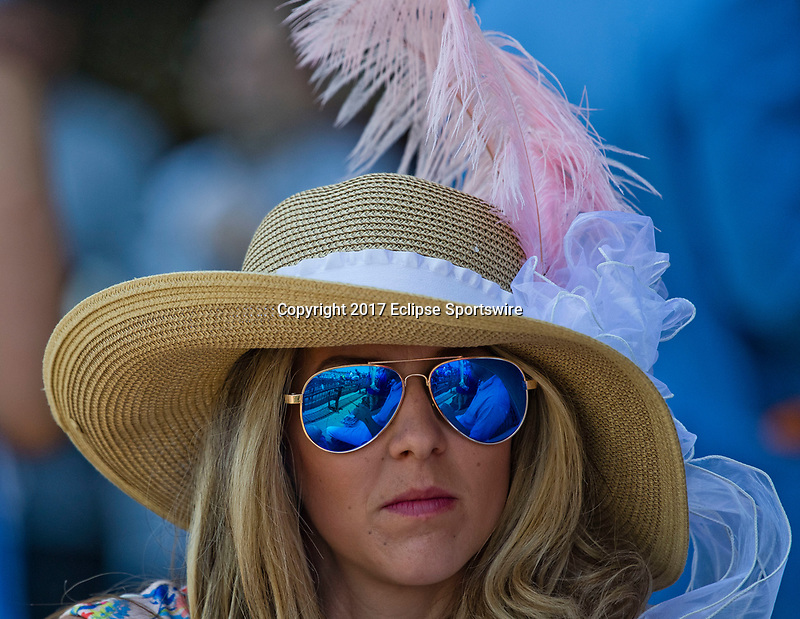 ELMONT, NY - JUNE 10: A woman wears a fancy hat and sunglasses on Belmont Stakes Day at Belmont Park on June 10, 2017 in Elmont, New York (Photo by Scott Serio/Eclipse Sportswire/Getty Images)
