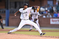Asheville Tourists starting pitcher Johendi Jiminian #31 delivers a pitch during a game against the Hagerstown Suns at McCormick Field on September 9, 2014 in Asheville, North Carolina. The Suns defeated the Tourists 4-3. (Tony Farlow/Four Seam Images)