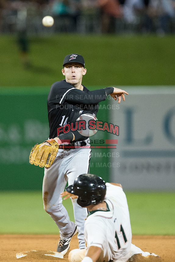 Kannapolis Intimidators shortstop Max Dutto (14) makes a throw to first base as Aaron Blanton (11) of the Greensboro Grasshoppers slides into second base at NewBridge Bank Park on July 7, 2016 in Greensboro, North Carolina.  The Dash defeated the Pelicans 13-9.  (Brian Westerholt/Four Seam Images)