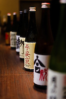 "Bottles of sake for tasting at the Tsukinokatsura sake brewery. Fushimi, Kyoto, Japan, October 10, 2015. Tsukinokatsura Sake Brewery was founded in 1675 and has been run by 14 generations of the Masuda family. Based in the famous sake brewing region of Fushimi, Kyoto, it has a claim to be the first sake brewery ever to produce ""nigori"" cloudy sake. It also brews and sells the oldest ""koshu"" matured sake in Japan."