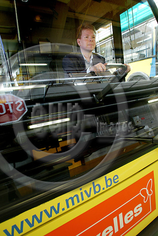 BRUSSELS - BELGIUM - 04 MAY 2005 --Jari PELTOLA behind the steering wheel on one of 130 Van Hool A500 busses at The Brussels Local Transport Co (STIB) for sale  on internet. They are manufactured in 1991 - 1992 by .-- PHOTO: ERIK LUNTANG / EUP-IMAGES..