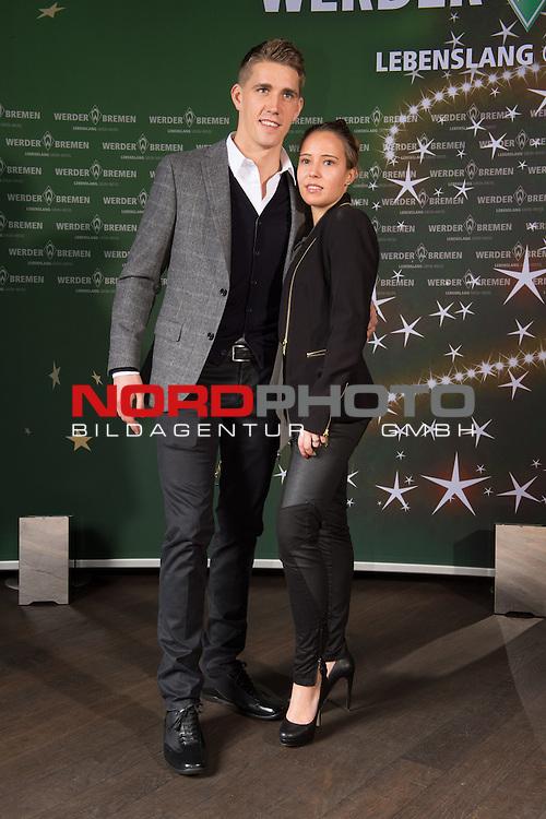 16.12.2013, GOP - Theater, Bremen, Weihnachtsfeier Werder Bremen 2013, im Bild<br /> <br /> Nils Petersen , mit Annemarie Ziege<br /> <br /> Foto &copy; nordphoto / Kokenge