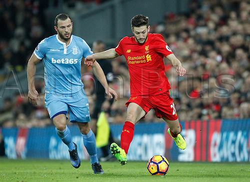 27.12.2016. Anfield, Liverpool, England.  EPL Premiership football, Liverpool versus Stoke. Liverpool midfielder Adam Lallana goes past Stoke City defender Erik Pieters.