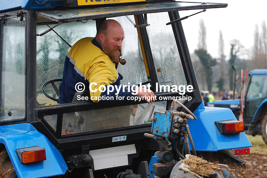 Tractor ploughing competitor. Taken 28 February 2009 at 95th annual ploughing match of Mullahead & District Ploughing Society, Co Down, N Ireland, UK, 200902281962..Copyright Image from Victor Patterson, 54 Dorchester Park, Belfast, UK, BT9 6RJ..Tel: +44 28 9066 1296.Mob: +44 7802 353836.Voicemail +44 20 8816 7153.Skype: victorpattersonbelfast.Email: victorpatterson@mac.com.Email: victorpatterson@ireland.com (back-up)..IMPORTANT: If you wish to use this image or any other of my images please go to www.victorpatterson.com and click on the Terms & Conditions. Then contact me by email or phone with the reference number(s) of the image(s) concerned.