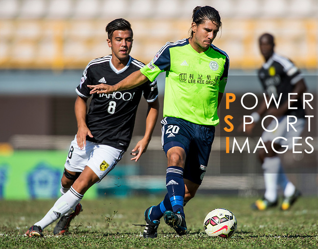 Aender Naves Mesquita of Wofoo Tai Po (R) followed by Michael Xavier Campion of Sun Pegasus FC (L) during the HKFA Premier League between Wofoo Tai Po vs Sun Pegasus at the Tai Po Sports Ground on 22 November 2014 in Hong Kong, China. Photo by Aitor Alcalde / Power Sport Images