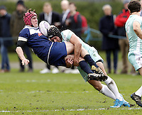 Jake Langmead-Jones (L) of Oxford is tackled by Sandy McCleery during the Pcubed Rugby League Varsity game between Oxford and Cambridge University at the HAC Ground, London, on Fri March 3, 2017