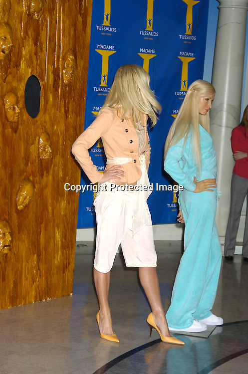 "Paris Hilton and her Wax Figure..at Madame Tussauds to reveal Paris Hilton's Wax Figure with the Cast of ""House of Wax"" on May 2, 2005 . ..Photo by Robin Platzer, Twin Images"
