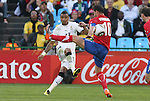 13 JUN 2010: Kevin Prince Boateng (GHA) (23) passes the ball past Dejan Stankovic (SRB) (10). The Serbia National Team lost 0-1 to the Ghana National Team at Loftus Versfeld Stadium in Tshwane/Pretoria, South Africa in a 2010 FIFA World Cup Group D match.