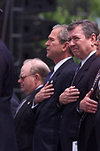 United States President George W. Bush, center, US Attorney General John Ashcroft, 2nd right, US Treasury Secretary Paul O'Neill, right, listen as New York Police Officer Daniel Rodriguez sings the US National Anthem at the start of the 20th Annual Peace Officers Memorial Service, which pays tribute to fallen law enforcement officers 15 May 2001 on the lawn of the US Capitol. More than 150 US police officers were killed in the line of duty last year.  <br /> Credit: Jamal A. Wilson / Pool via CNP