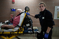 Arielle Vandette of Pro EMS moves patient Robert F. Fredo from an ambulance to the hospital in Cambridge, Massachusetts, USA.  Fredo, 87, was at a doctor's office when the doctor noticed heart irregularities during an examination.  The paramedics took a mobile EKG in the ambulance, which they then send to doctors at the hospital in advance of their arrival with the patient.