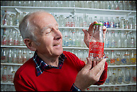 BNPS.co.uk (01202 558833)<br /> Pic: RachelAdams/BNPS<br /> <br /> Peter with one of the small bottles in his collection . <br /> <br /> In a glass of his own...<br /> <br /> Dairy-daft Peter Hayward is udderly devoted to his bizarre hobby - collecting vintage milk bottles.<br /> <br /> The 70-year-old has devoted the last 30 years to building up a whopping collection of more than 1,000 bottles.<br /> <br /> Peter, a former dairy worker, scours the south west of Britain in search of rare bottles emblazened with the colourful logos of old dairies.<br /> <br /> And since retiring 16 years ago his collection has swelled so much that he has been forced to turn his garage into a mini museum.<br /> <br /> Peter's obsession with milk started as a 10-year-old when he helped his local milkman on his weekend rounds to earn some pocket money.<br /> <br /> He later joined Express Dairies as a distribution manager, working alongside hundreds of independent dairy farmers.<br /> <br /> When he retired in the late 1990s Peter had amassed a sizeable collection in his office - and decided to devote his free time to growing it.