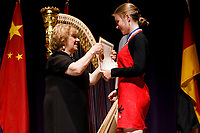 Miriam Ruf from Germany receives the HarpMasters Academy Prize (sixth prize) during the awards ceremony of the 11th USA International Harp Competition at Indiana University in Bloomington, Indiana on Saturday, July 13, 2019. (Photo by James Brosher)