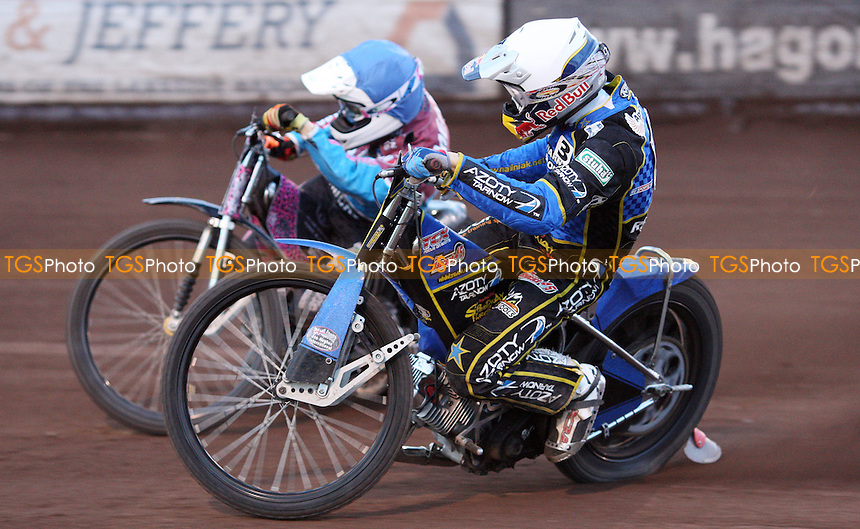 Heat 12: Robert Mear (blue) and Maciej Janowski (white) - Lakeside Hammers vs Kings Lynn Stars, Elite League Speedway at the Arena Essex Raceway, Pufleet - 22/06/12 - MANDATORY CREDIT: Rob Newell/TGSPHOTO - Self billing applies where appropriate - 0845 094 6026 - contact@tgsphoto.co.uk - NO UNPAID USE..