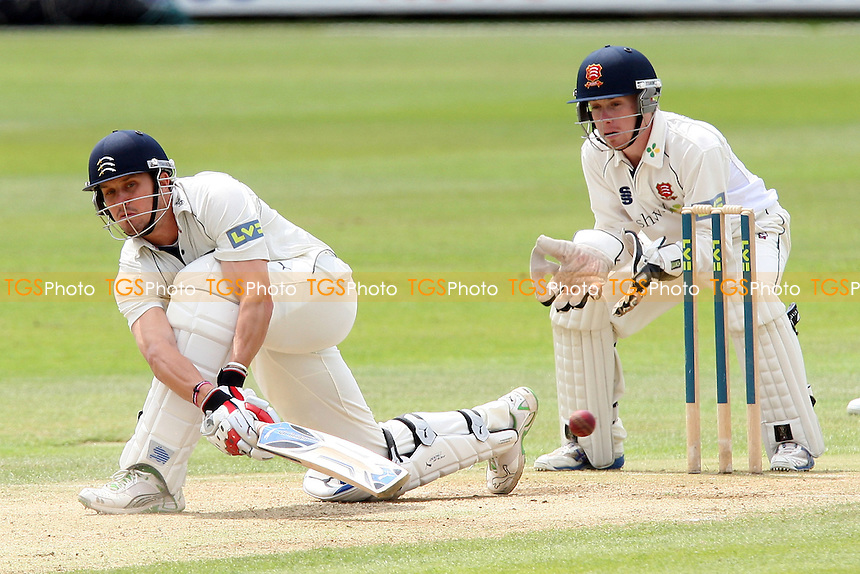 Nick Compton plays the sweep shot for Middlesex as Adam Wheater looks on from behind the stumps - Essex CCC vs Middlesex CCC-  LV County Championship Cricket at the Ford County Ground, Chelmsford -  08/06/09 - MANDATORY CREDIT: Gavin Ellis/TGSPHOTO - Self billing applies where appropriate - Tel: 0845 094 6026