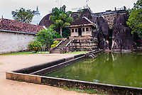 Isurumuniya Vihara, a Buddhist cave temple at the Sacred City of Anuradhapura, Cultural Triangle, Sri Lanka, Asia. This is a photo of Isurumuniya Vihara, a Buddhist cave temple in the Sacred City of Anuradhapura, a complex of ancient Buddhist temple ruins. The Sacred City of Anuradhapura is a UNESCO World Heritage Site in an area known as the Cultural Triangle of Sri Lanka.