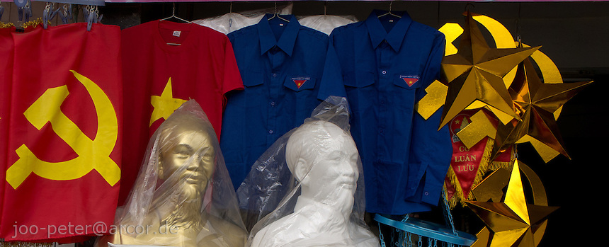 shop with communist items like flags and busts of Ho Chi Minh in city Hue, Vietnam