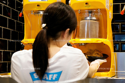 "A member of staff prepares a shaved ice during the pre-opening event of the new shaved ice restaurant ""Ice Monster"" in Omotesando shopping area of Shibuya district on April 27, 2015, Tokyo, Japan. Ice Monster is a Taiwanese store, which sells giant shaved ice desserts. It was selected as one of the ""Best Dessert 10"" by CNN and ""Best Desserts Around the World"" by Travel and Leisure Magazine. The store will open to the public on April 29th. (Photo by Rodrigo Reyes Marin/AFLO)"