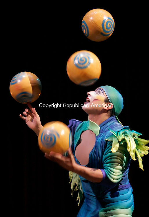 "HARTFORD, CT--21 September 2005- 092105JS11--A juggler performs during Wednesday's special performance of Cirque du Soleil ""Varekai""  in Hartford. The show, which opens on Thursday, runs through October 16 in a tent on Market Street at I-84 and I-91 in Hartford.    Jim Shannon / Republican American--Cirque du Soleil; Varekai; Hartford;  are CQ"
