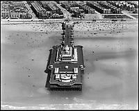 BNPS.co.uk (01202 558833)<br /> Pic: Aerofilms/HistoricEngland/BNPS<br /> <br /> Blackpool Victoria Pier, July 1920.<br /> <br /> Stunning historic aerial photos of seaside towns, naval bases, ports and shipyards which tell the story of Britain's once-great maritime tradition feature in a new book.<br /> <br /> The fascinating archive of black and white images includes views from a bygone age such as Brighton's famous West Pier, Grimsby's burgeoning fishing fleet, and London's dock yards.<br /> <br /> Iconic ships were also captured from the skies including the Cutty Sark in its final seaworthy years on the Thames, HMY Britannia in 1959, the RMS Queen Mary in 1946 and the SS Queen Elizabeth in 1969 about to make her maiden voyage.<br /> <br /> England's Maritime Heritage from the Air, by Peter Waller, is published by English Heritage and costs &pound;35.