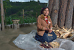 Jovita Guzman, a Maya Mam woman, pulls the grain off of corn at her home in Comitancillo, Guatemala.