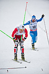 HOLMENKOLLEN, OSLO, NORWAY - March 16: (L) Martin Johnsrud Sundby of Norway (NOR) finishes 2nd place. (R) Roland Clara of Italy (ITA) comes in 5th place during the Men 50 km mass start, free technique, at the FIS Cross Country World Cup on March 16, 2013 in Oslo, Norway. (Photo by Dirk Markgraf)