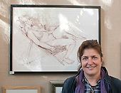 Prize winning artist at the opening of an exhibition of students' work, Adult Learning Centre, Guildford, Surrey.