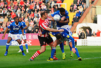 Lincoln City's Matt Rhead vies for possession with Macclesfield Town's Michael Rose, front, and Macclesfield Town's Zak Jules<br /> <br /> Photographer Chris Vaughan/CameraSport<br /> <br /> The EFL Sky Bet League Two - Lincoln City v Macclesfield Town - Saturday 30th March 2019 - Sincil Bank - Lincoln<br /> <br /> World Copyright © 2019 CameraSport. All rights reserved. 43 Linden Ave. Countesthorpe. Leicester. England. LE8 5PG - Tel: +44 (0) 116 277 4147 - admin@camerasport.com - www.camerasport.com