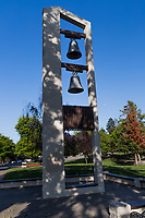 Low in the west, the sun shines through trees, casting shadows on the bell tower at San Filipe Community Park, Hayward, California.  Meanwhile, the waxing moon provides a mostly white, mostly innocuous, period at the end of the bell tower sentence.  Celestial punctuation.