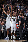 Doral Moore (4) and Bryant Crawford (13) of the Wake Forest Demon Deacons reacts after a teammate made a three-point basket during second half action against the Notre Dame Fighting Irish at the LJVM Coliseum on February 24, 2018 in Winston-Salem, North Carolina. The Fighting Irish defeated the Demon Deacons 76-71.  (Brian Westerholt/Sports On Film)