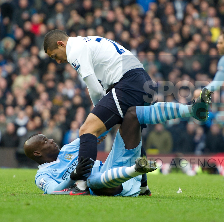 Mario Balotelli of Manchester City clashes with Kyle Walker of Tottenham.Barclays Premier League.Manchester City v Tottenham at the Eithad Stadium, Manchester 22nd January, 2012..Sportimage +44 7980659747.picturedesk@sportimage.co.uk.http://www.sportimage.co.uk/.Editorial use only. Maximum 45 images during a match. No video emulation or promotion as 'live'. No use in games, competitions, merchandise, betting or single club/player services. No use with unofficial audio, video, data, fixtures or club/league logos.