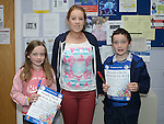 Meabh and Declan McCabe who took part in the Louth Fleadh competitions in St. Oliver's Community College Drogheda pictured with their teacher Orla Brannigan. Photo:Colin Bell/pressphotos.ie