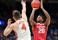 NWA Democrat-Gazette/CHARLIE KAIJO Arkansas Razorbacks forward Darious Hall (20) takes a shot as Florida Gators guard Egor Koulechov (4) covers during the Southeastern Conference Men's Basketball Tournament quarterfinals, Friday, March 9, 2018 at Scottrade Center in St. Louis, Mo.