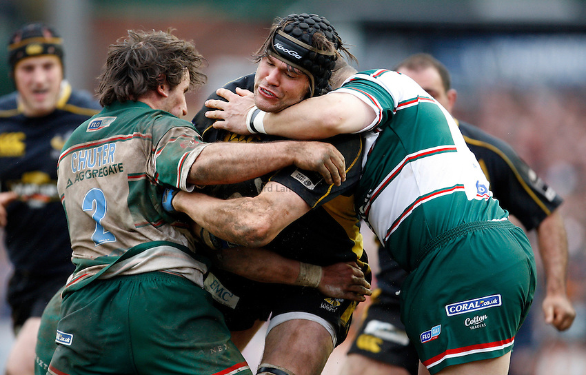 Photo: Richard Lane/Richard Lane Photography..Leicester Tigers v London Wasps. Guinness Premiership. 29/03/2008. Wasps' Tom Palmer is tackled by the Tigers' defence.