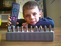 Young boy plays with his tool kit received as a Christmas gift. From Palm Pre camera.
