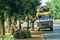 Farmer selling forest products on the road