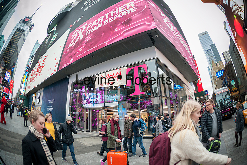 A spanking brand new T-Mobile mobile phone store opens in Times Square in New York, seen on Thursday, February 4, 2016. (© Richard B. Levine)