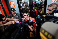 Nov. 14, 2008; Homestead, FL, USA; NASCAR Sprint Cup Series driver Tony Stewart is interviewed by the media during practice for the Ford 400 at Homestead Miami Speedway. Mandatory Credit: Mark J. Rebilas-