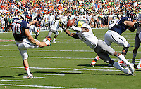 Oregon wide receiver Josh Huff (1) block the punt of DUPLICATE***Virginia punter Alec Vozenilek (30)***Virginia running back LaChaston Smith (30) Oregon defeated Virginia 59-10 during an NCAA college football game at Scott Stadium, Saturday, Sept. 7, 2013, in Charlottesville, Va. (Photo/Andrew Shurtleff)