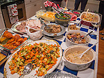 Thanksgiving table foods assortmant on counter.