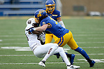 SIOUX FALLS, SD - NOVEMBER 3: Eric Kleinschmit #31 from South Dakota State brings down Lorenzo Thomas #84 from Missouri State during their game Saturday afternoon at Dana J. Dykhouse Stadium in Brookings. (Photo by Dave Eggen/Inertia)
